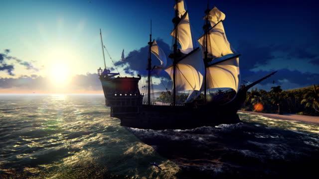 ett stort medeltida skepp i havet vid solnedgången. en gammal medeltida skepp dockad nära en öde tropisk ö. - segelfartyg bildbanksvideor och videomaterial från bakom kulisserna