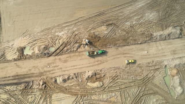 große schlammige baustelle - luftbild - aerial view soil germany stock-videos und b-roll-filmmaterial
