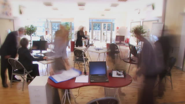 Large office team time lapse people