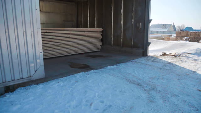 Large production hangar for storage of wood products video