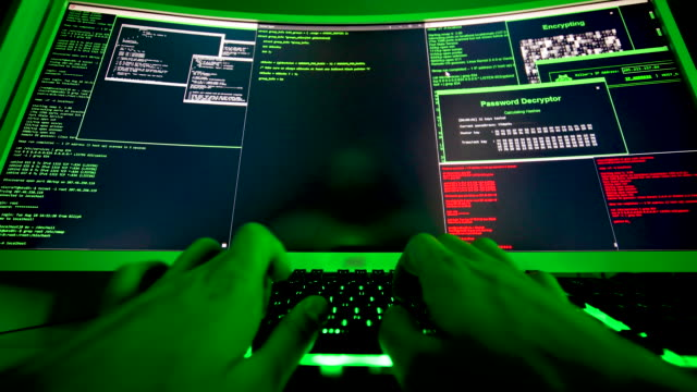 Large screen of code for hacker, hands typing malicious code. A black-hat programmer hacking into illegal personal data. Coding ransomware attack to steal personal data in cyber attack. identity theft stock videos & royalty-free footage
