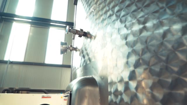 large stainless steel wine distilling tanks. silos for wine and beer fermentation . steel barrels for fermentation of wine in winemaker factory . close up - acciaio inossidabile video stock e b–roll