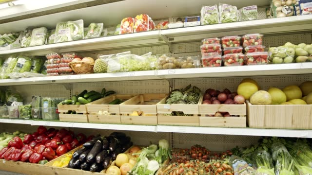 Large variety of vegetables and fruits on a supermarket shelves