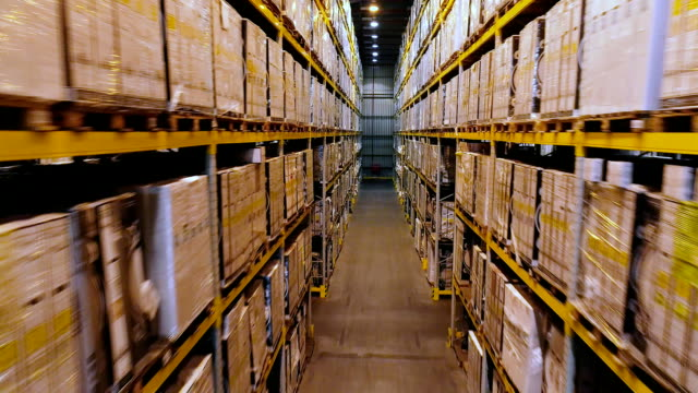 Large warehouse with white boxes, flying in a modern warehouse without people Large warehouse with white boxes, flying in a modern warehouse without people. warehouse stock videos & royalty-free footage