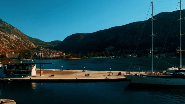 A large yacht stands at the pier in the bay Kotor, Montenegro. Aerial footage video