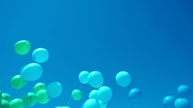 large-scale launch of helium balloons on a big holiday in the clear blue sky. entertainment industry, organization of mass events, festive mood large-scale launch of balloons at the big holiday. entertainment industry, organization of mass events levitation stock videos & royalty-free footage
