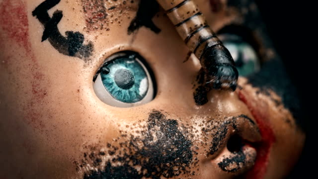 larva crawls on the face of an old doll, close-up larva crawls on the face of an old doll, close-up FullHD doll stock videos & royalty-free footage