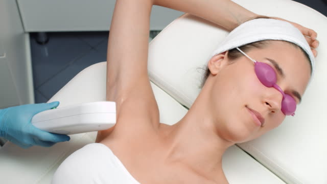Laser armpit hair removal procedure. Female client. video