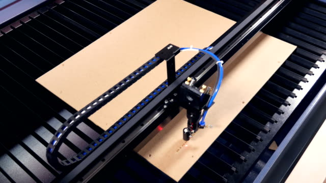 laser cutting machine for wood working with plywood. 4k. - incisione oggetto creato dall'uomo video stock e b–roll