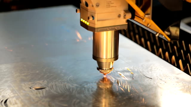 CNC Laser cutting of metal, modern industrial technology. CNC Laser cutting of metal modern industrial technology. Laser cutting works by directing the output of a high-power laser through optics. Laser optics and CNC computer numerical control. metalwork stock videos & royalty-free footage