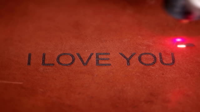 Laser machine engraves the inscription on the skin-I love you video