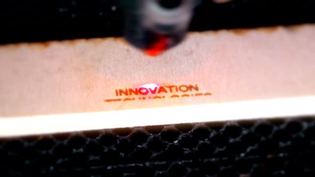 laser machine operation during engraving - incisione oggetto creato dall'uomo video stock e b–roll