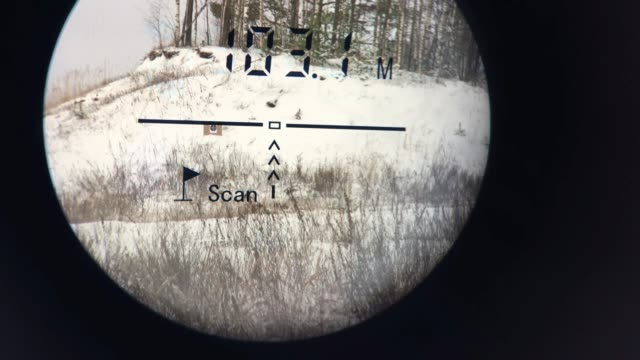 Laser rangefinder for the rifle is aimed at the target.