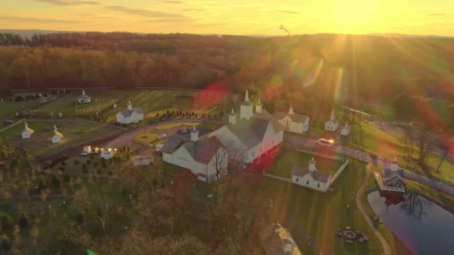 Late Afternoon Fall Aerial View of Beautiful Restored Barns and Countryside