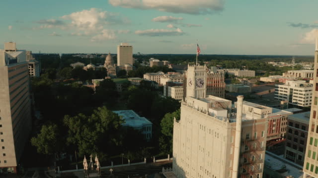 Late Afternoon in the Downtown City Center of Jackson Mississippi Light illuminates the statehouse dome in the Mississippi state capital building florida us state stock videos & royalty-free footage