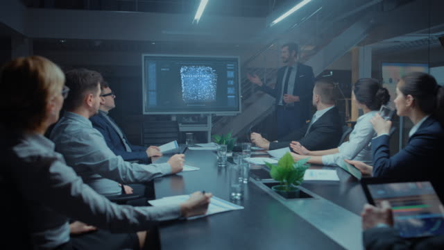 late at night in technological startup meeting room: chief engineer talks uses digital whiteboard to present new neural network, ai, data mining solution to a board of directors, investors and venture capitalists - conferenza stampa video stock e b–roll