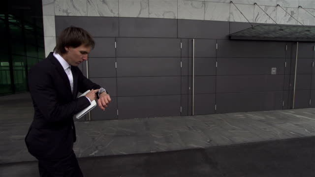 SLOW MOTION: late businessman skateboarding to work video