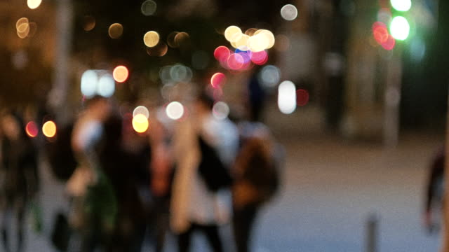late night urban group unrecognizable blurred people with cinematic grain - city walking background video stock e b–roll