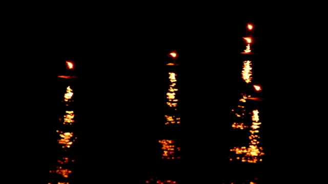 late spark birthday candles waving,nice ocean water surface reflection video