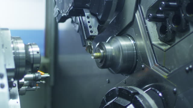 CNC Lathe Machine Produces Metal Detail on Factory. CNC Lathe Machine Produces Metal Detail on Factory. Shot on RED Cinema Camera in 4K. grooved stock videos & royalty-free footage