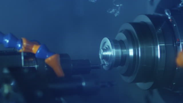 CNC Lathe Machine Produces Metal Detail on Factory. CNC Lathe Machine Produces Metal Detail on Factory. Shot on RED Cinema Camera in 4K. metal worker stock videos & royalty-free footage