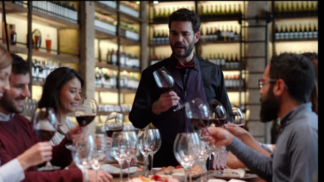 Latin American couples during a wine tasting smelling the scent of wine following sommelier Latin American couples during a wine tasting smelling the scent of wine following sommelier - food and drinks concepts winetasting stock videos & royalty-free footage
