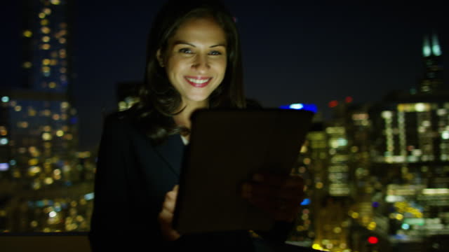 Latin American female manager using tablet at night video