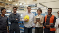 istock Latin American team of employees at a manufacturing water pump factory all smiling at camera 1206324528