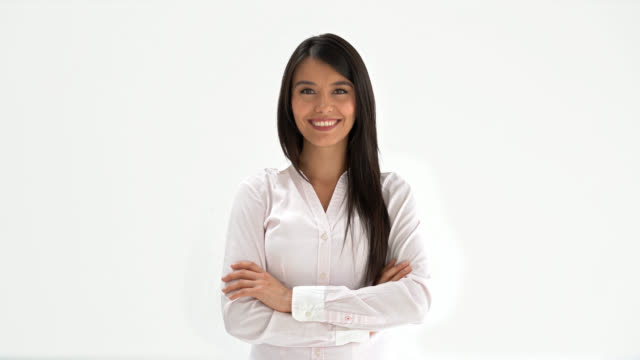 Latin american woman looking at the camera with arms crossed video
