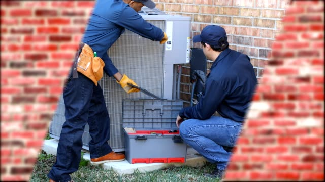 Latin and African American blue collar workers fixing ac unit in backyard video