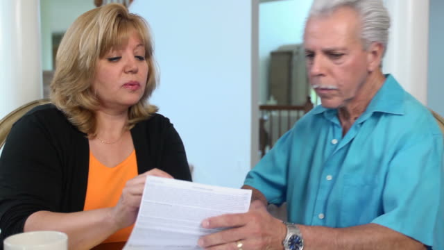 Latin Couple Work on Home Finances - WS video