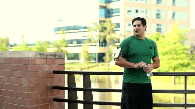 Latin descent man exercising in downtown city area. video