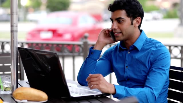 Latin, middle eastern business man working at outdoor cafe. video