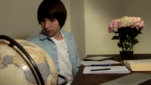 Latin Teen Male Studies Geography at Home video