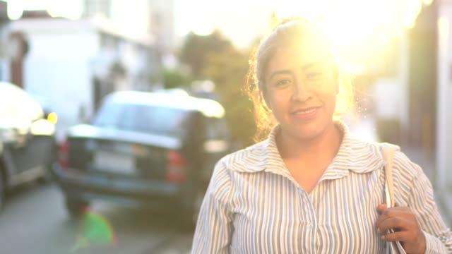 Latin woman shopping in the street