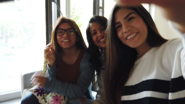 Latin women at home, relaxing and taking a break from studying - video