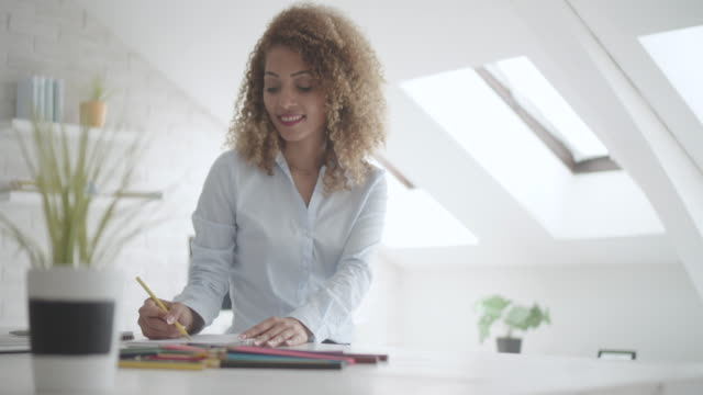 Latina Businesswoman Coloring Book In Her Office. video