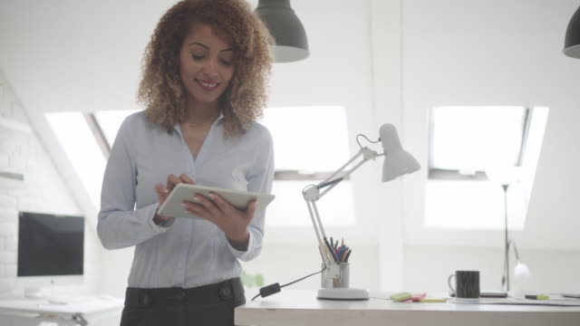 Latina Businesswoman Using Digital Tablet In Her Office video