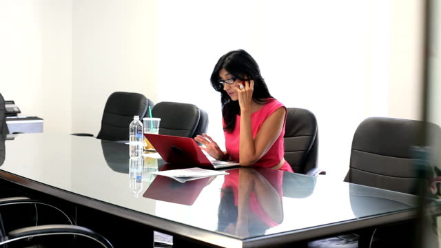 Latina businesswoman woking hard  in conference room video