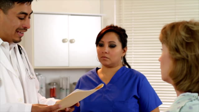 Latino Doctor talking to Mature Patient