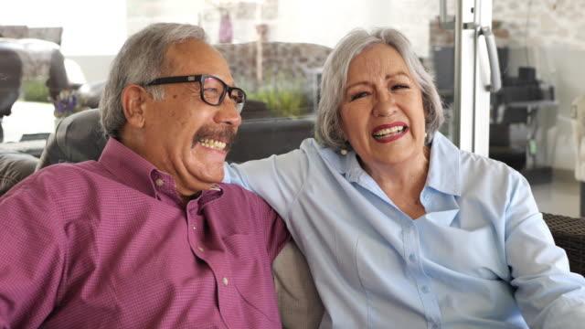 Latino senior couple enjoying retirement with loved ones.