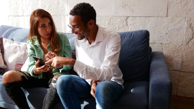Latino woman and mixed race guy are young couple, enjoying moments at home