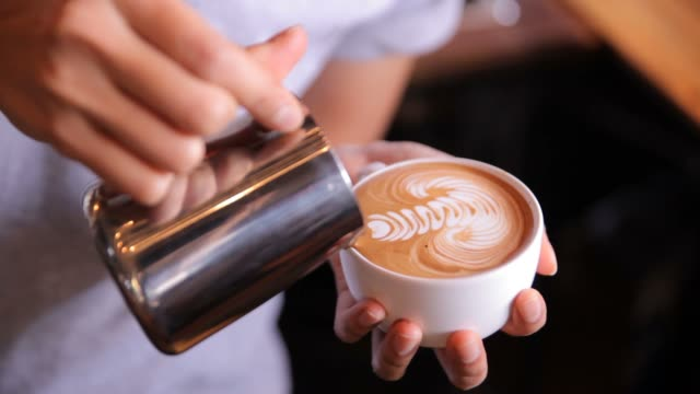 Latte art Making, HD Making Latte art,Milk pouring and serving by a Barista coffee stock videos & royalty-free footage