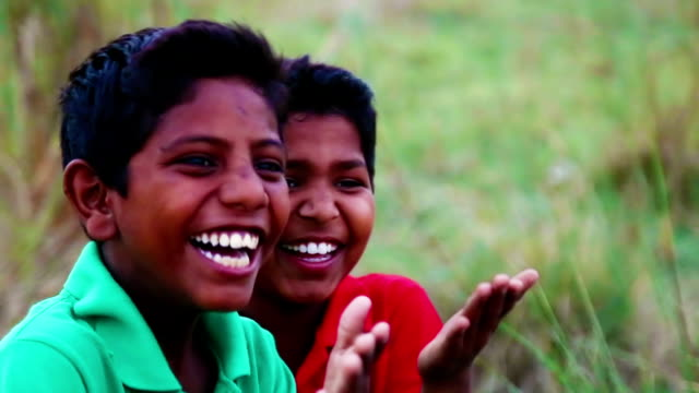 Laughing children Laughing children outdoor in the nature portrait close up. developing countries stock videos & royalty-free footage