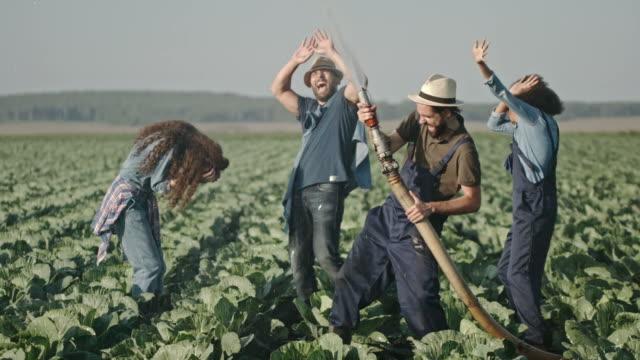 Laughing Farmer Splashing Water on Friends video