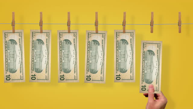 $10 Launder line conveyor, back side of $10 dollar bills on yellow background