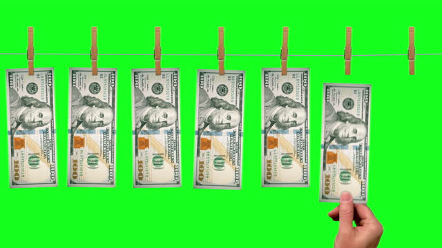 $100 Launder line conveyor, front side of $100 dollar bills on green screen