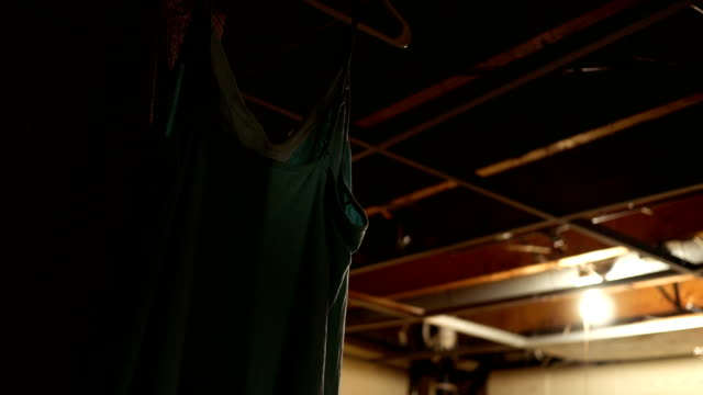 Laundry hanging in dark unfinished basement via broken dryer situation video