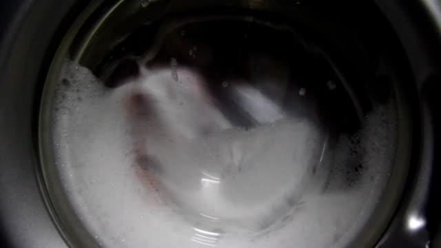 Laundry inside a washing machine drum video