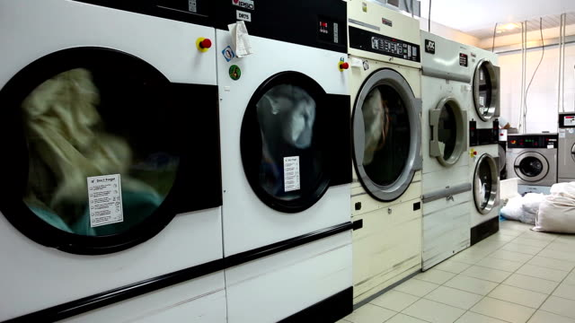 Laundry. View of automatic washing machines video